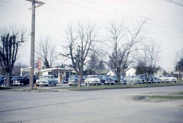 some neat pictures of an old corner car lot new and used photo picture. Black Bedroom Furniture Sets. Home Design Ideas