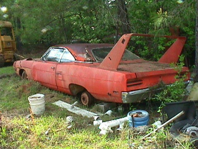 1970 Plymouth Superbird sitting in the woods for a long time.
