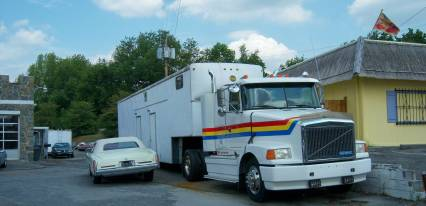 White GMC truck with 45 RV race trailer