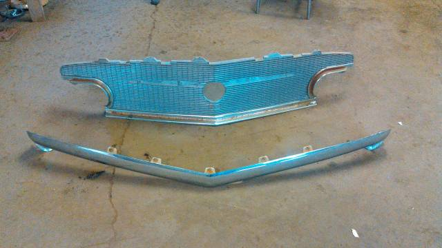 56 buick grill and upper bar parting cars